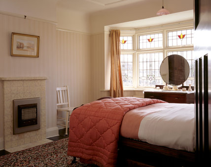 The Front Bedroom at Mendips, from the door, showing the window and fireplace