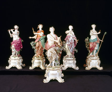 Close view of four Muses & Apollo figures from a larger group