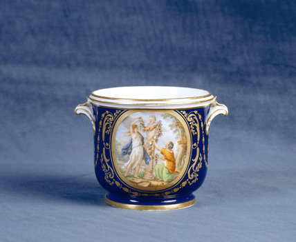 Close view of Sevres Wine Cooler,showing nymphs worshipping the bust of Pan, from a service made for Louis XVI, dated 1792, in the Porcelain Lobby at Upton House