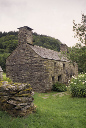 End on view of Ty Mawr and outbuilding, restored to its probable its probable 16th century appearance