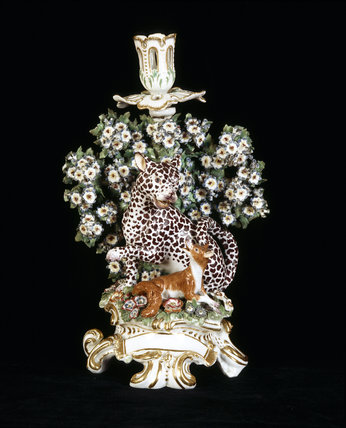A close view of a Chelsea porcelain candlestick depicting the Leopard and Fox from Aesops' Fables, c