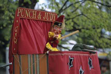 Punch the puppet in traditional costume on stage at the Morden Hall Park Countryside and Craft Fair