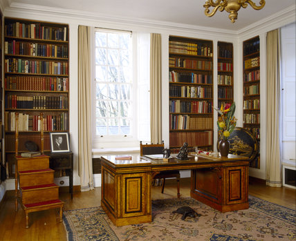 Room view of the Library at Upton House with a desk, library steps and bookshelves