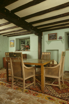 The Sitting Room showing a painted table at Monk's House with chairs by Duncan Grant and Vanessa Bell c.1930