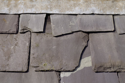 A close up of old and broken slates in need of repair at Dudmaston Hall
