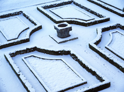 The parterre at Clandon Park, taken in Janaury with a thick layer of snow covering the topairy hedges and paths