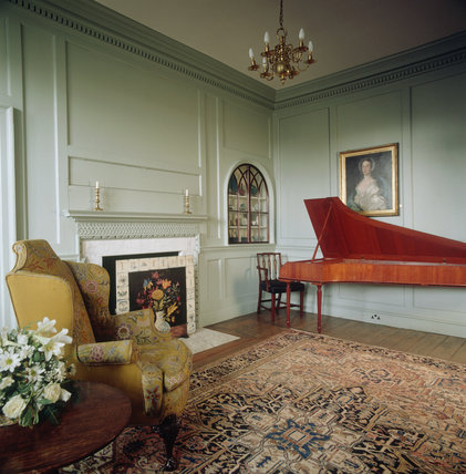 Room view of the Georgian Room showing a harpsicord, fireplace and decorative firescreen