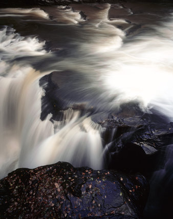 A detail of the Waterfall at Aberdulais Falls, taken from the top level, showing the blur of the water rushing over the rocks
