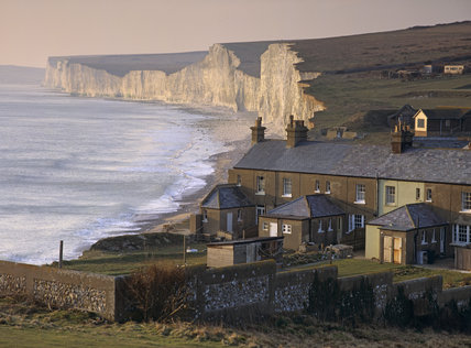 The terrace of coastguard cottages at Birling Gap with the Seven Sisters in the background