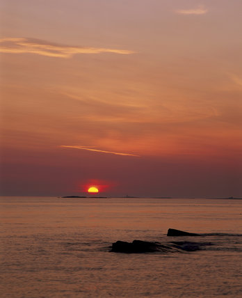 Sunrise over distant Farne Islands, Northumberland