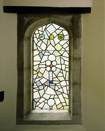 An Art Nouveau Stained Glass Window On The Staircase At