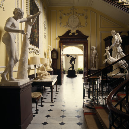 Sculptures of animals and humans line the Staircase Hall at Hatchlands