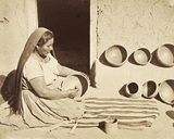 Woman polishing a pottery vessel