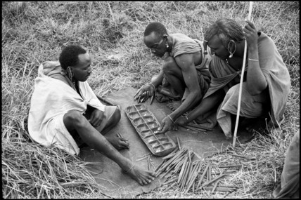 Maasai men playing mancala
