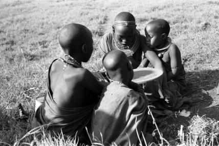 Maasai women preparing ochre