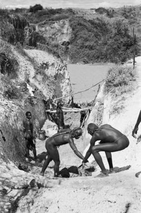 Maasai moran repairing a cattle ramp