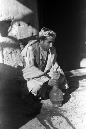 Pathan man smoking a water-pipe