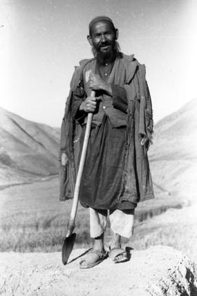 Hazara farmer holding a spade