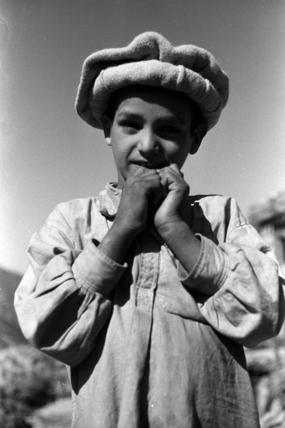 Nuristani boy wearing a felt hat