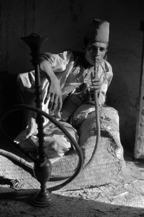 Man smoking a water-pipe