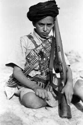 Udhr boy with a rifle