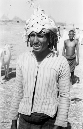 Arab man wearing a palm frond hat