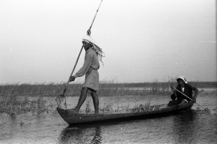 Madan men spear fishing