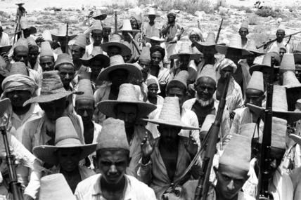 Arab men wearing straw hats