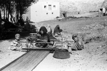 Hazara women weaving