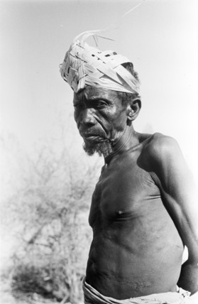 Arab slave wearing a palm frond hat