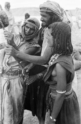 Saar men and a woman