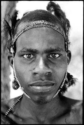Samburu youth wearing a headdress