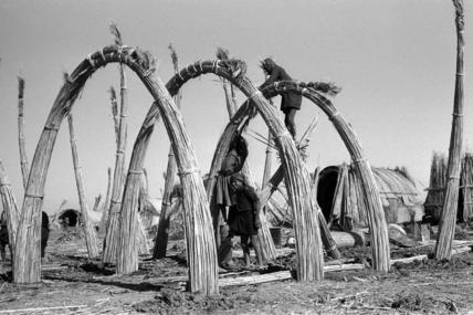 Suaid men constructing a house