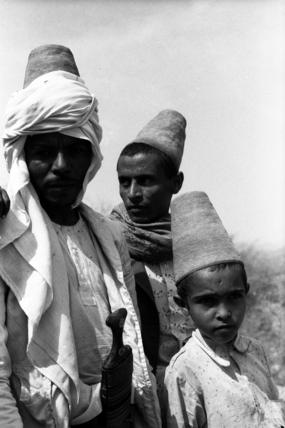 Arab men wearing conical hats