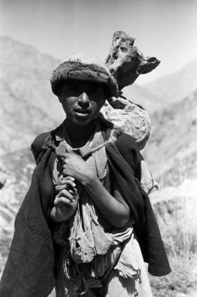 Gujar man carrying a bag