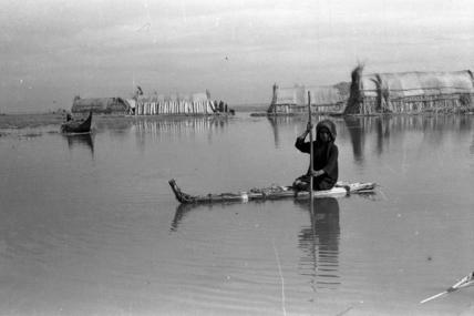 Suaid boy paddling a raft