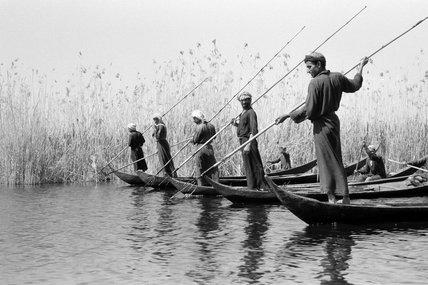 Fartus men spear fishing