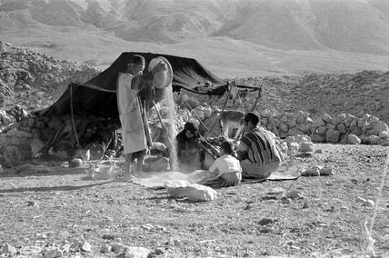 Bakhtiari man winnowing grain