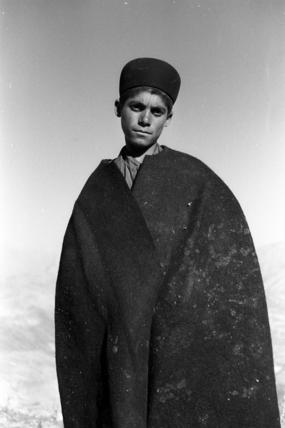 Bakhtiari boy wearing a cloak