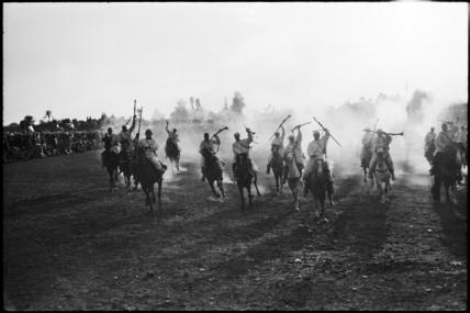 Berber men on horseback