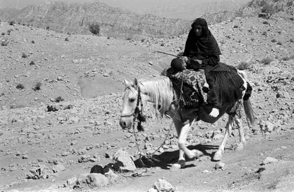 Bakhtiari woman on horseback