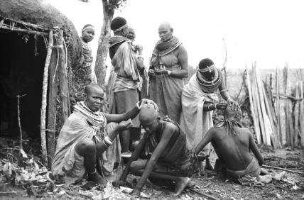 Shaving initiates' heads