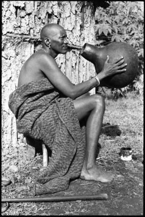 Samburu man with a beer pot