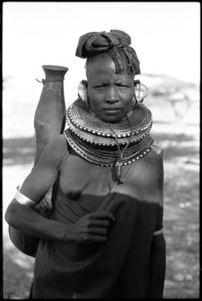 Turkana woman carrying a water vessel