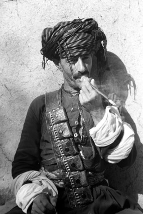 Pizdhar man smoking a pipe