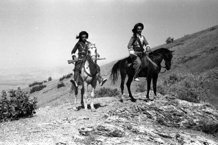 Pizdhar men on horseback