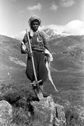 Baliki boy holding a spade