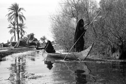 Poling a canoe