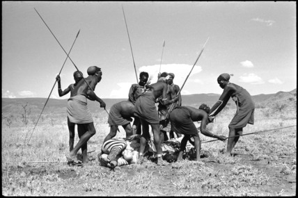 Pokot men butchering a zebra