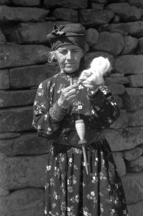 Assyrian woman spinning wool